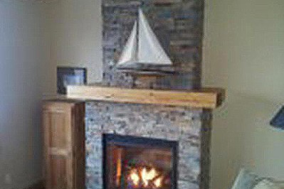 Regency-Propane-fireplace-with-ledgestone