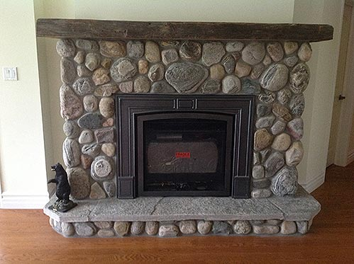 Valor-propane-fireplace-with-river-stone