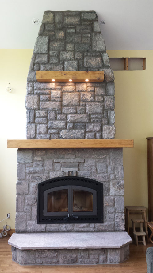 Montecito-Estate-wood-burning-fireplace-with-random-rectangular-granite