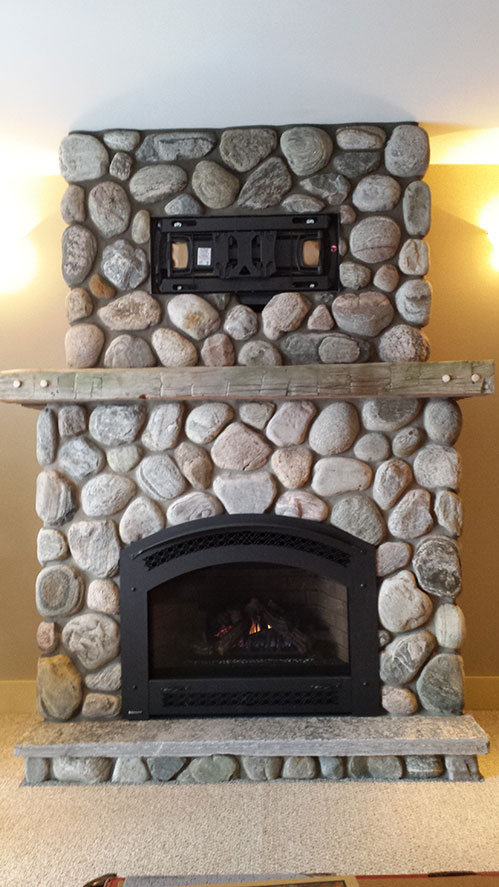 Regency-P90-Excalibur-gas-fireplace-with-river-stone-and-TV-bracket